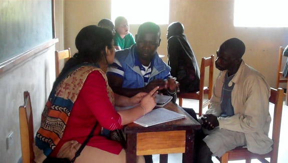 Northwestern Law students paired with Youth Watch Society (YOWSO) paralegals interview remand prisoners in the Mzuzu Prison in Malawi