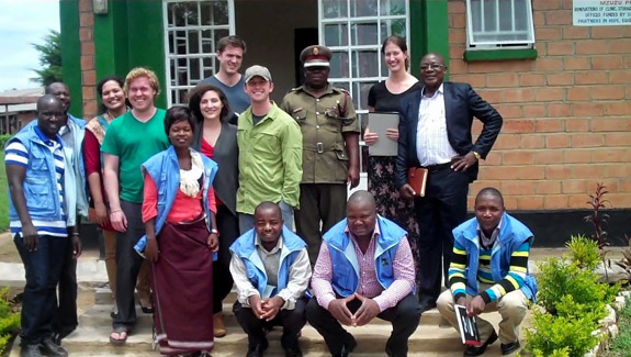 Northwestern Law team with Malawi officials and YOWSO paralegals outside Mzuzu Prison